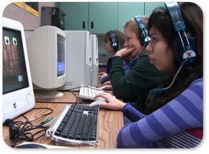 3 kids at computer Education Through Time