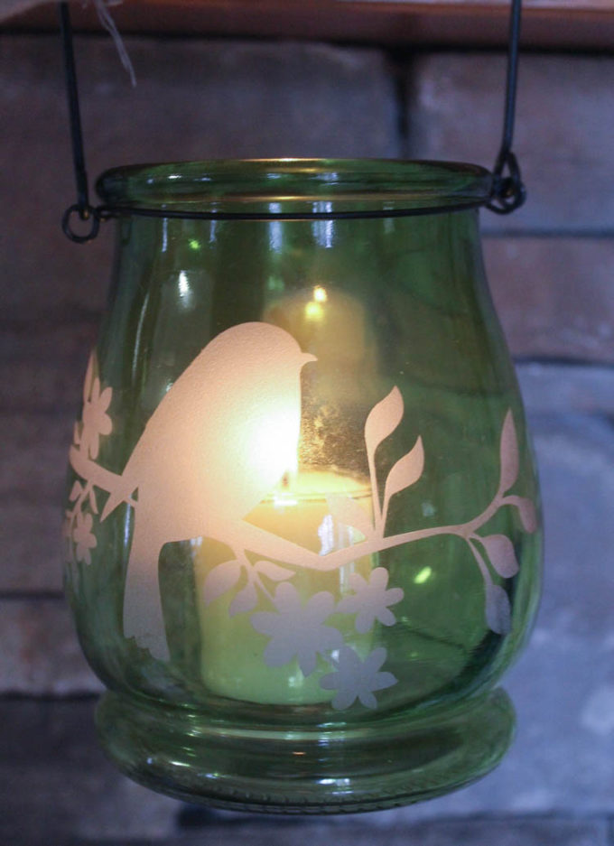Reuse a vase to create a beautiful luminary to brighten up summer nights or as an emergency lantern for when the power goes out.