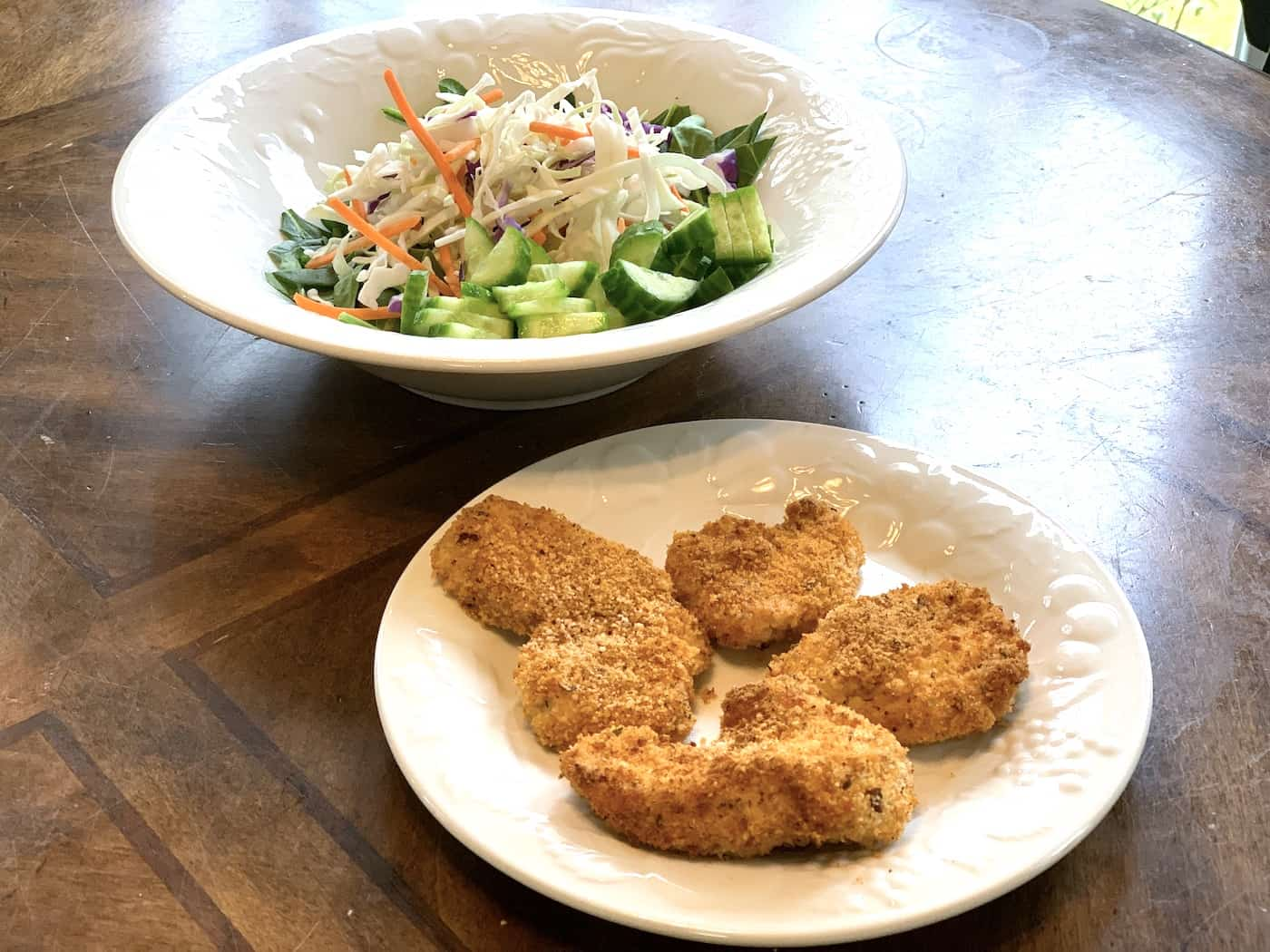 gf chicken tenders from air fryer with salad 25 Air Fryer Chicken Recipes to Add to Your Monthly Meal Plan