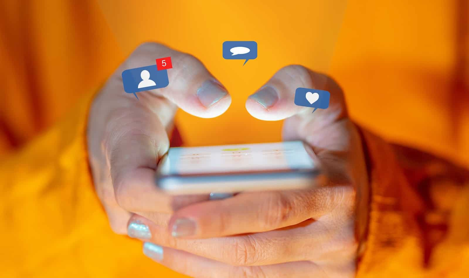 Close up of teenager or adult woman on social media on smartphone with social network notification icons of like, message, friends, love, heart. In online Connections and technology.