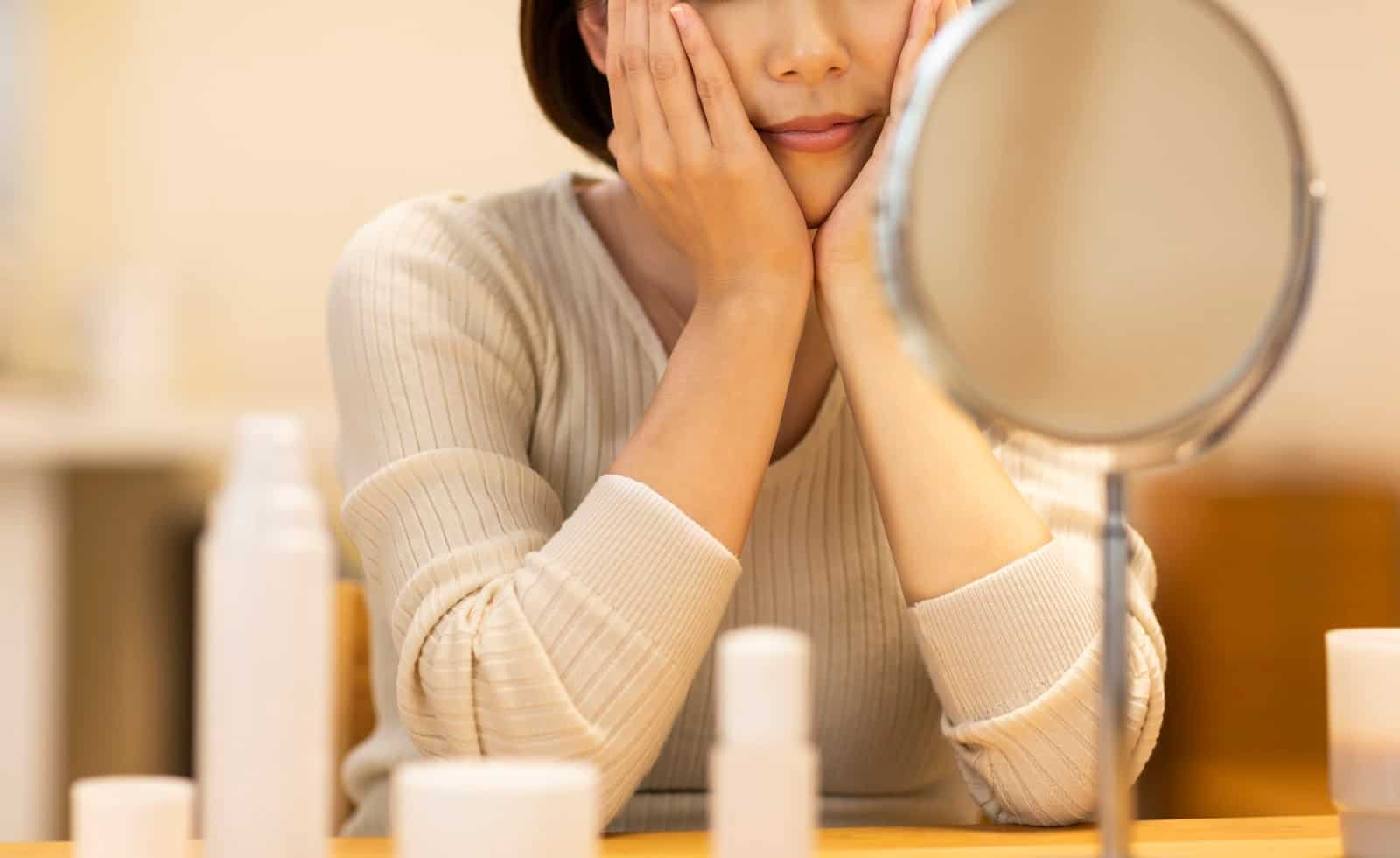 Woman prepping for her nighttime beauty routine