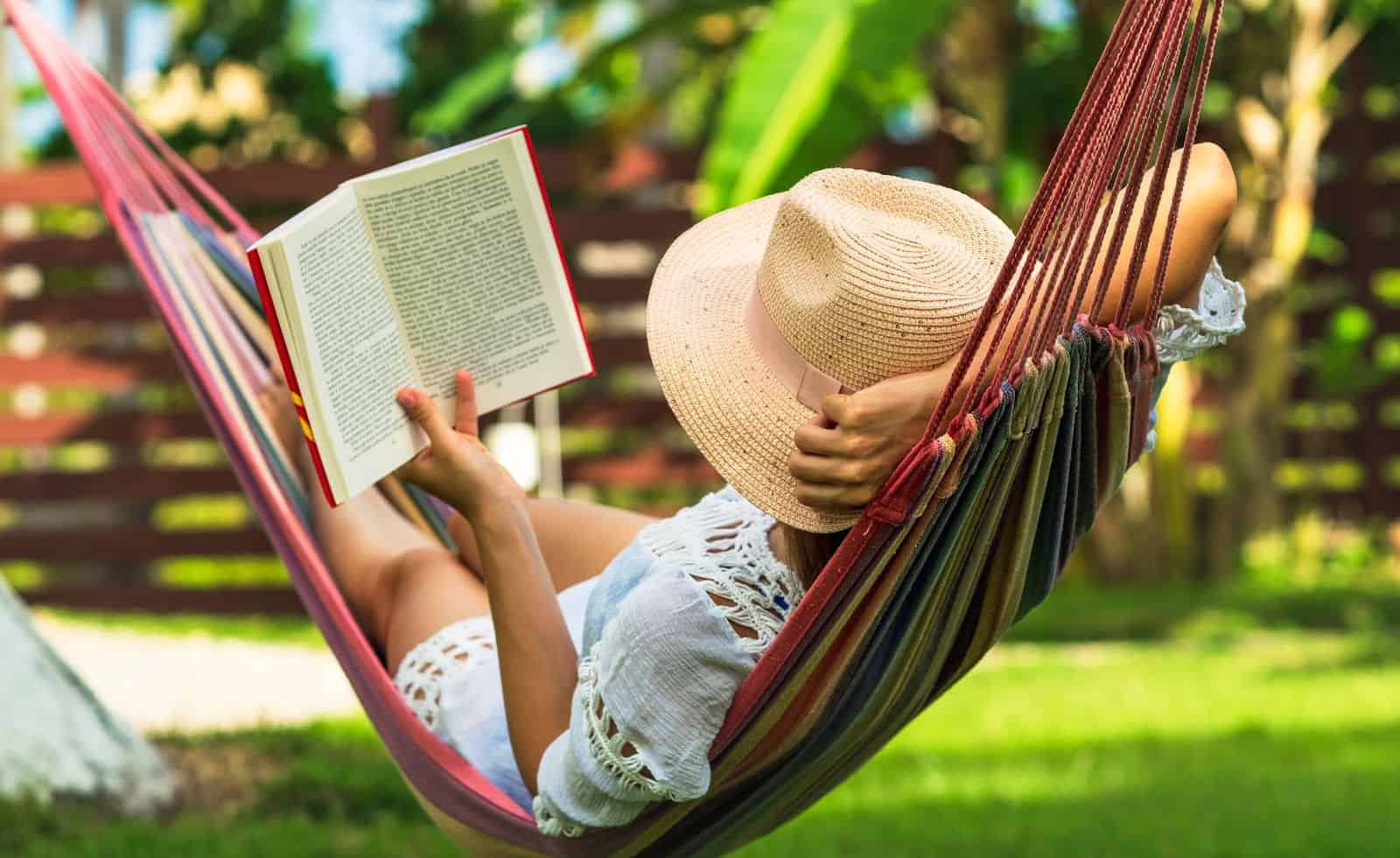 woman reading during the summer in a hammock