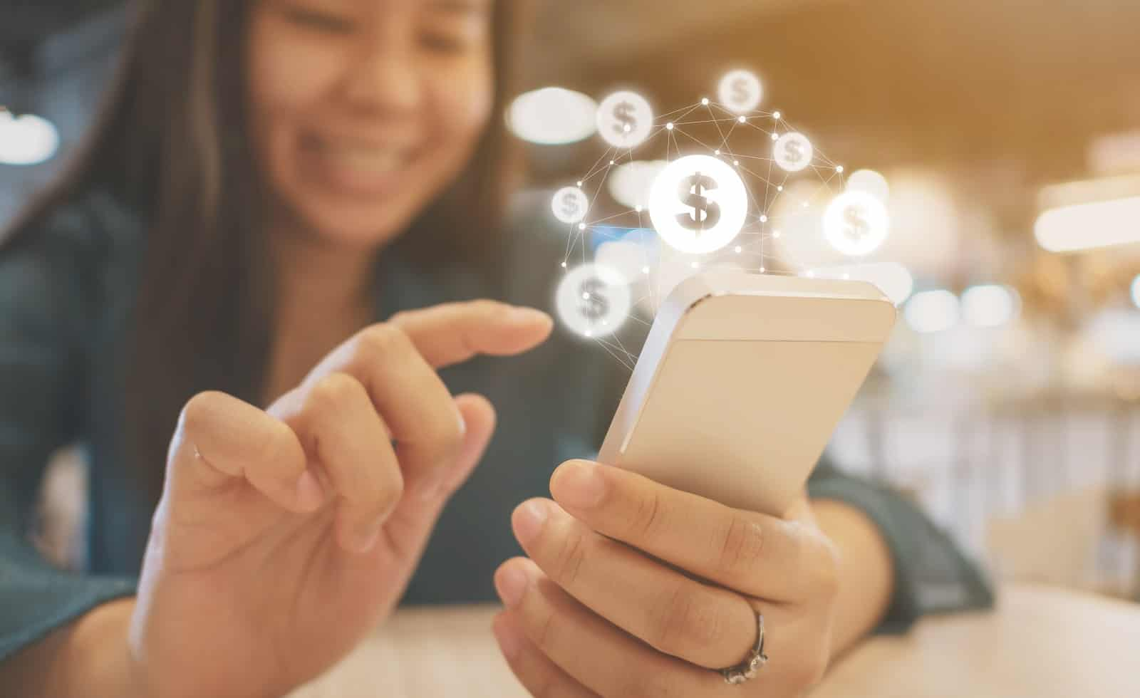 Teen using mobile phone with online transaction application, Concept financial technology (fin-tech)
