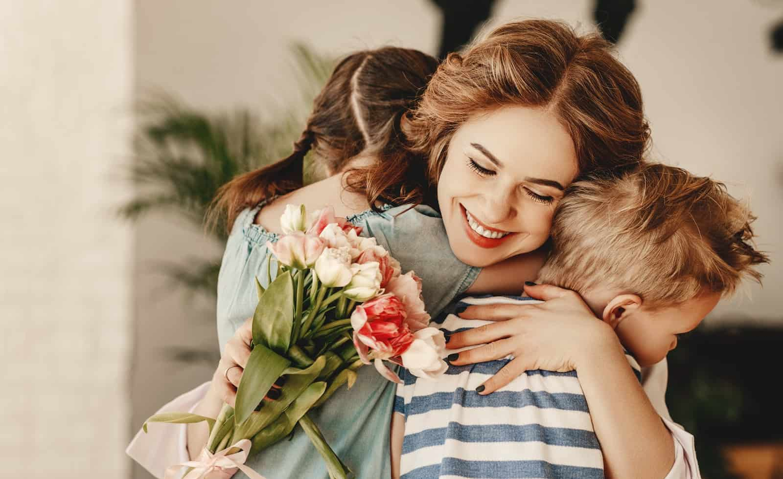 mom smiling and hugging her kids- subscription boxes for mom