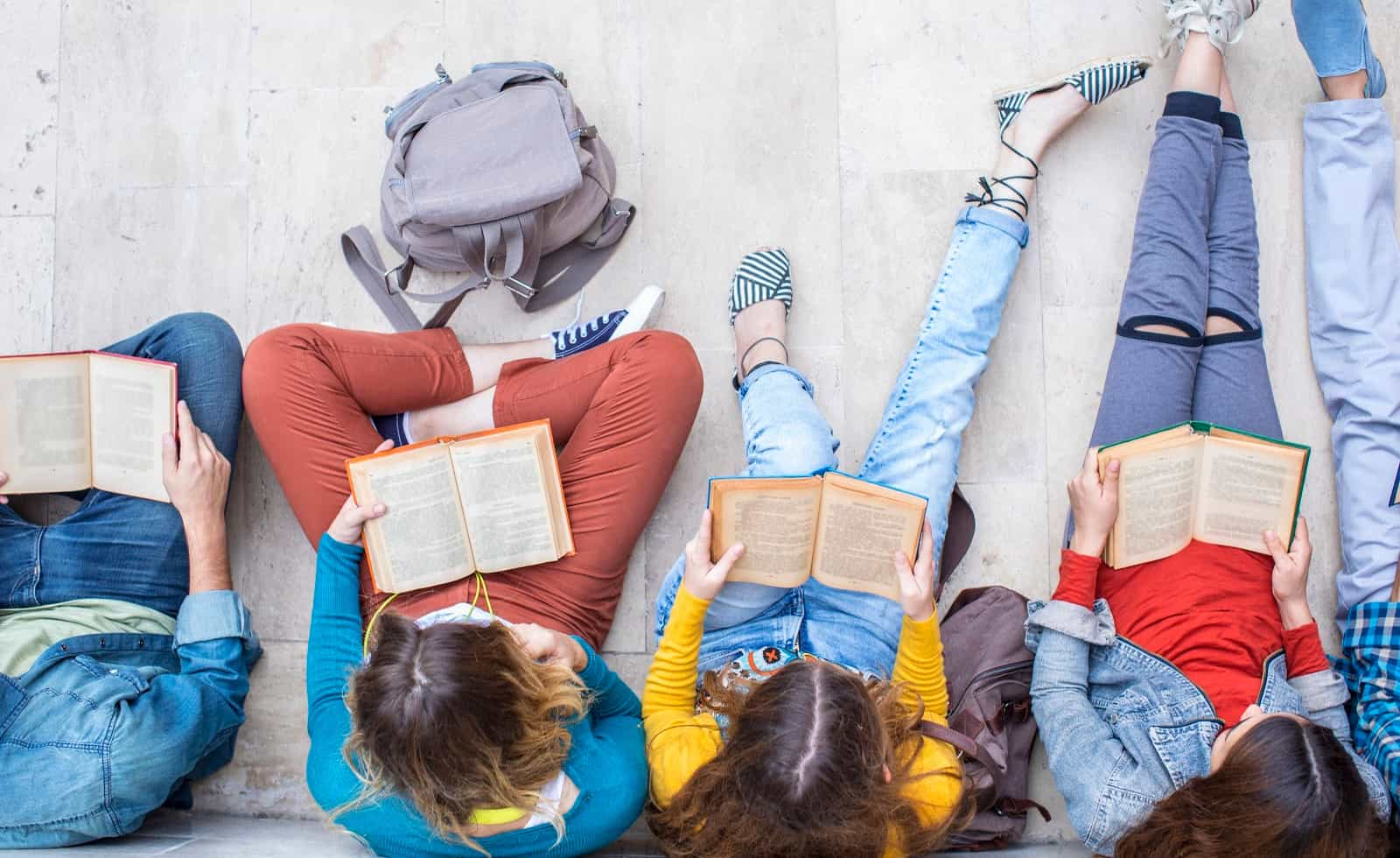 teens reading books from the 2021 ya summer reading list